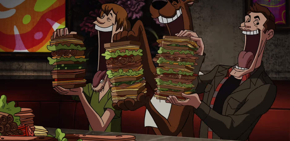 Supernatural's Dean scarfs sandwiches Scooby Doo-style in crossover