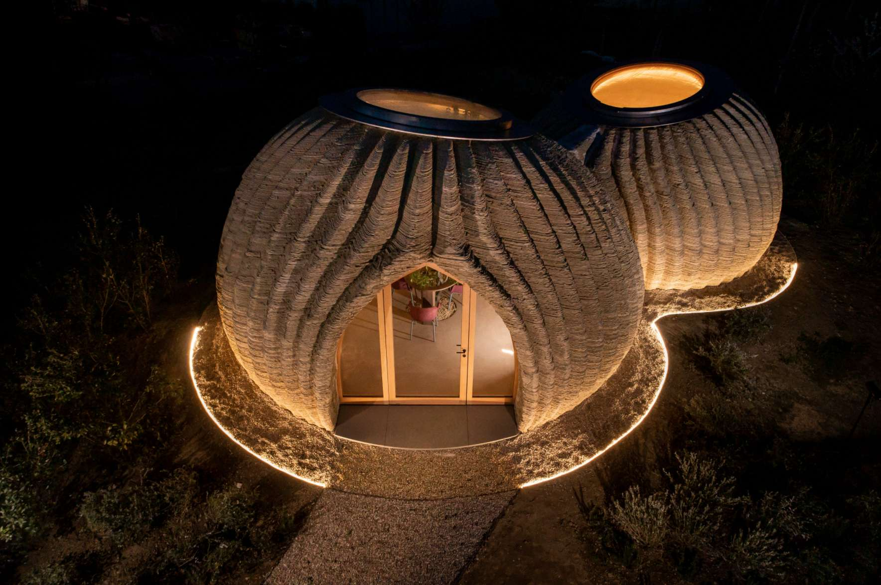World's first raw earth material 3D-printed house is ready for residents