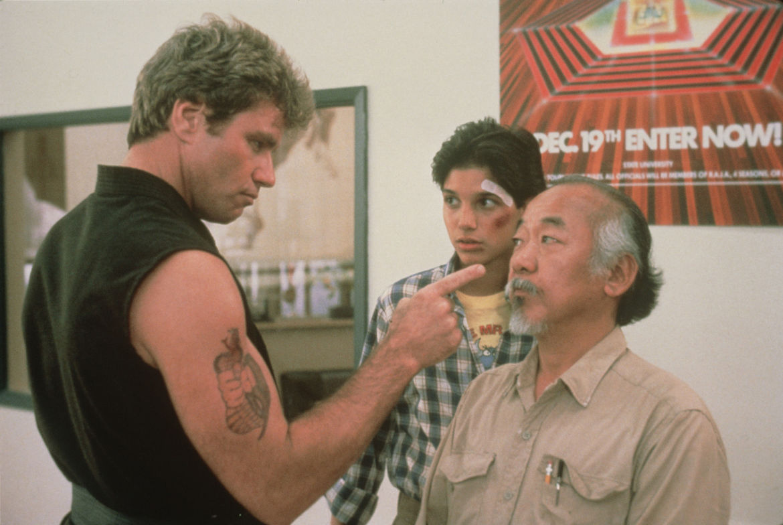 Martin Kove, Ralph Macchio, and Pat Morita in The Karate Kid