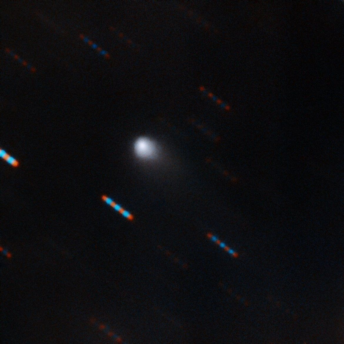 The interstellar comet 2I/Borisov imaged by the massive Gemini telescope on 9-10 September 2019. The telescope tracked the comet and took several images in red and blue filters, so the stars appear as a trail of multi-colored dots.