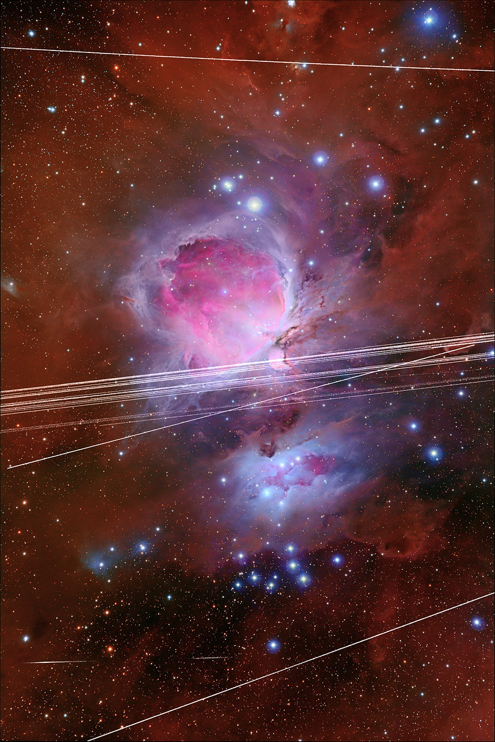 The Orion Nebula, crisscrossed with satellite streaks.