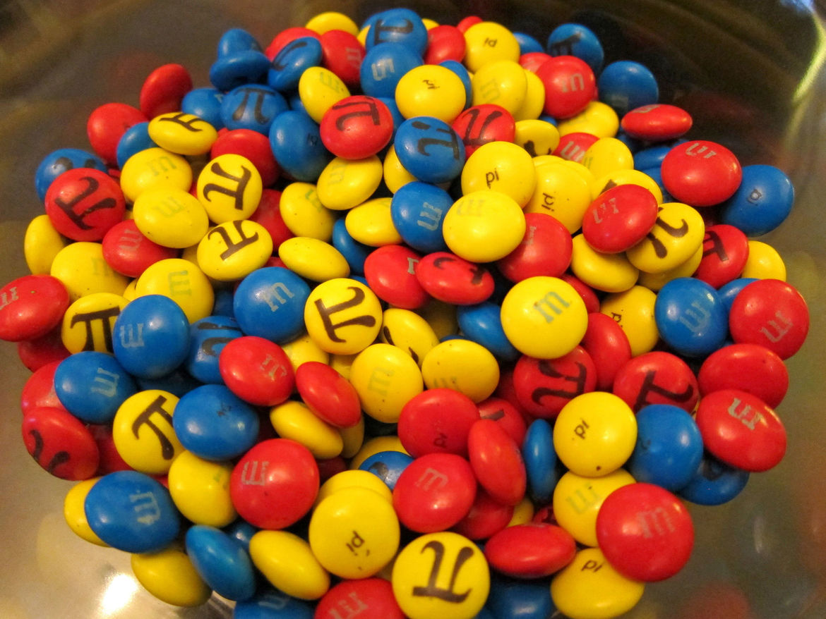 Approximating the shape of an M&M as an oblate spheroid, the volume of chocolate in it is 4/3πa2b, where a is the long radius and b the short one. Credit: AmitP on Flickr