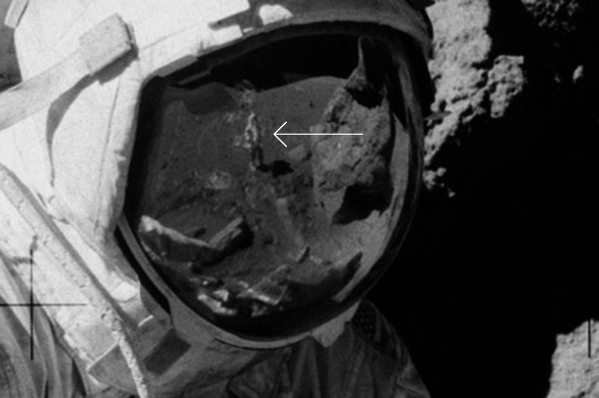 A close-up of Cernan's visor shows a figure standing there. Who could it be? Guess. Credit: NASA