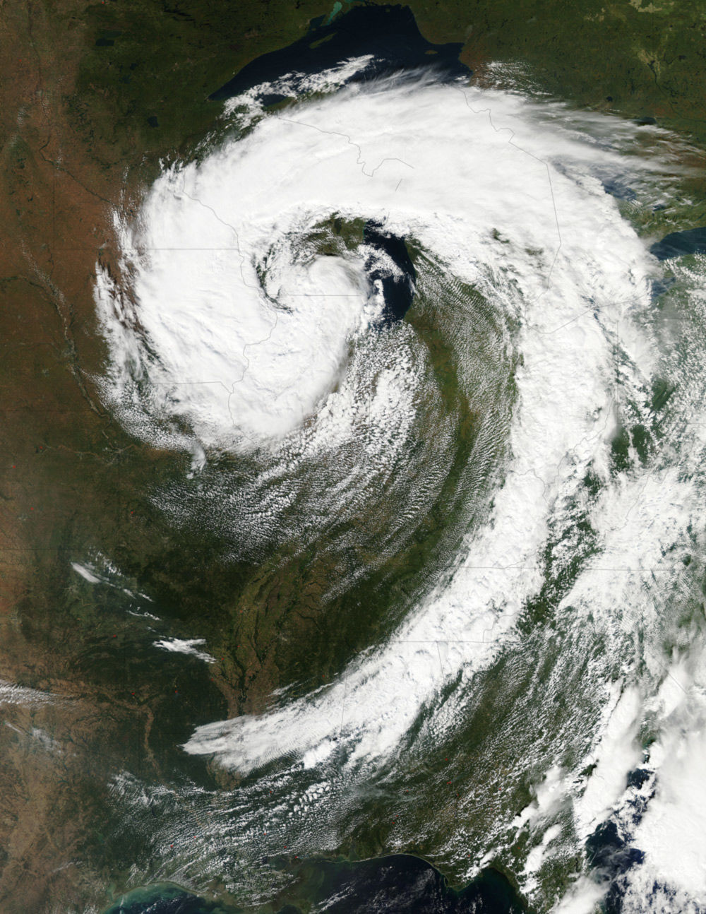 Aqua satellite image of a low pressure storm system over the Great Lakes.