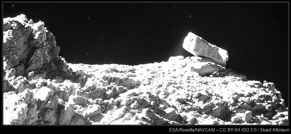 An amazing, unearthly scene: A huge block of rock sitting on the surface of a comet. Credit: ESA/Rosetta/MPS for OSIRIS Team MPS/UPD/LAM/IAA/SSO/INTA/UPM/DASP/IDA & Stuart Atkinson