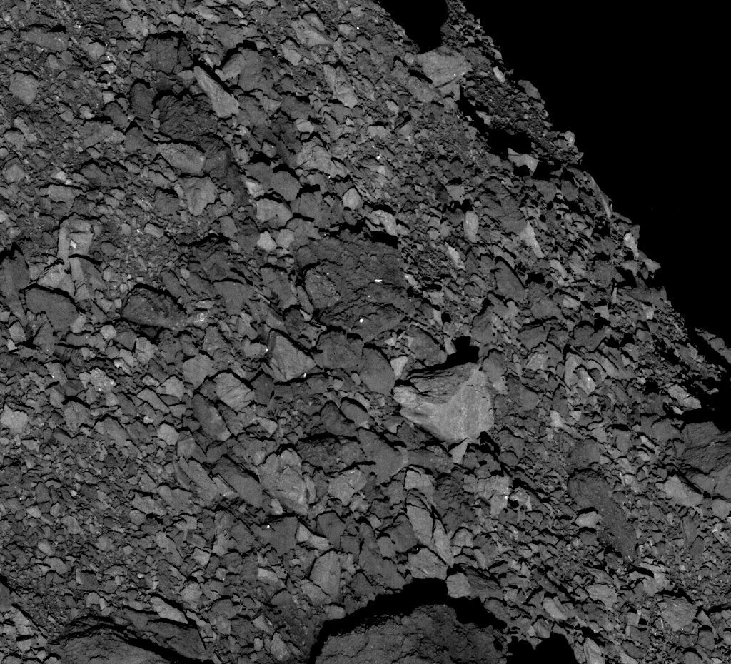 The surface of Bennu is not exactly smooth. Taken from 5 km up, this OSIRIS-REx image shows boulders of all sizes. The biggest (the light-colored one left of center) is over 7 meters wide. Credit: NASA/Goddard/University of Arizona