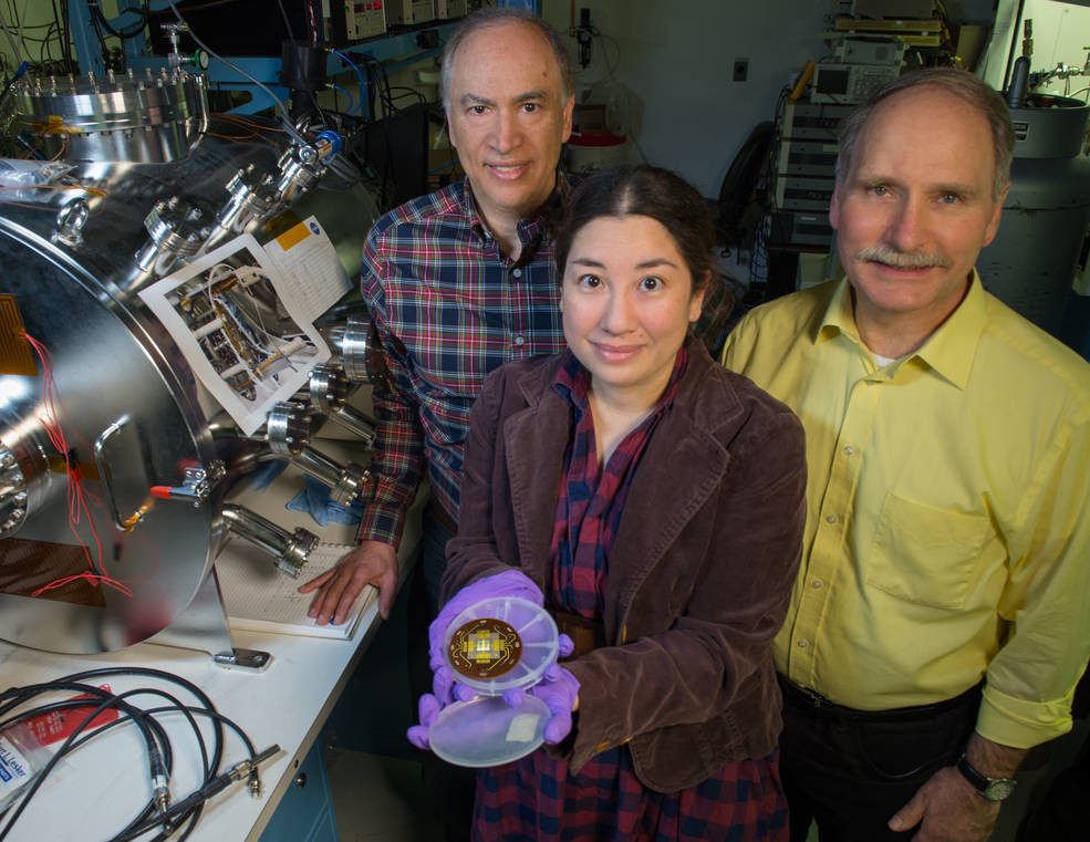 NASA image of scientists with electron emitter