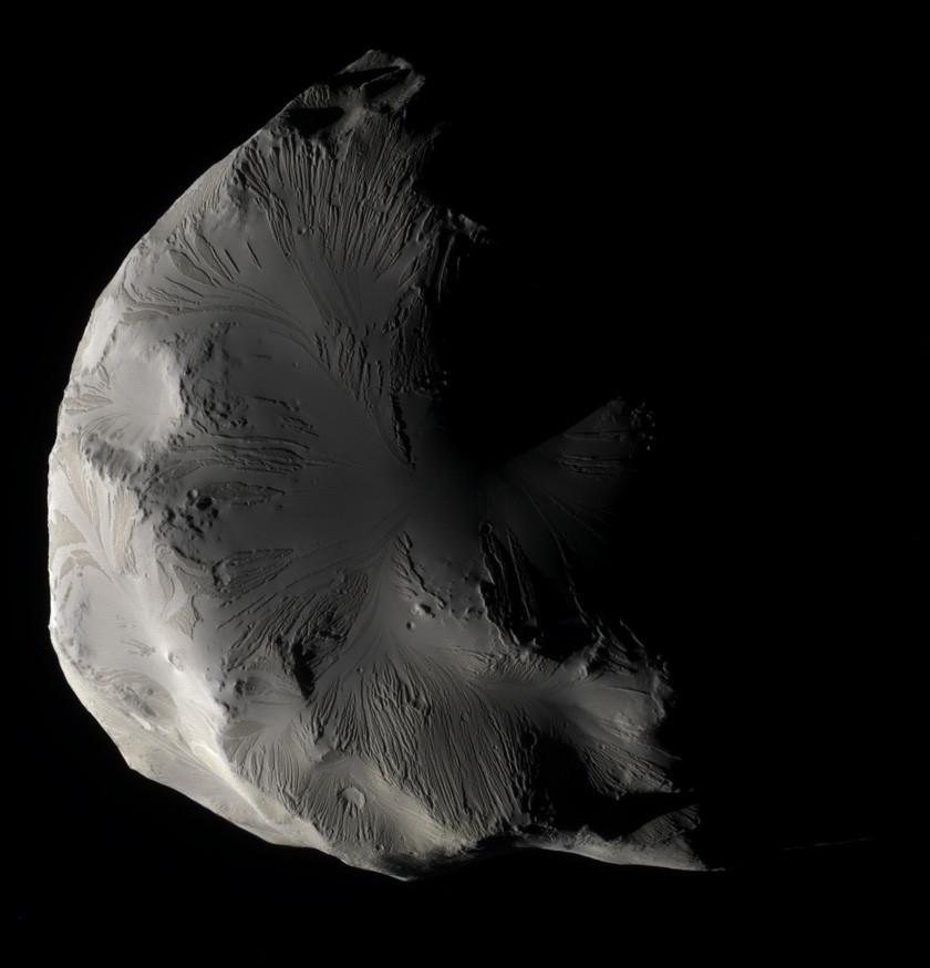 Helene is an oddball, if not really a ball. Credit: NASA / JPL / SSI / color composite by Daniel Macháček