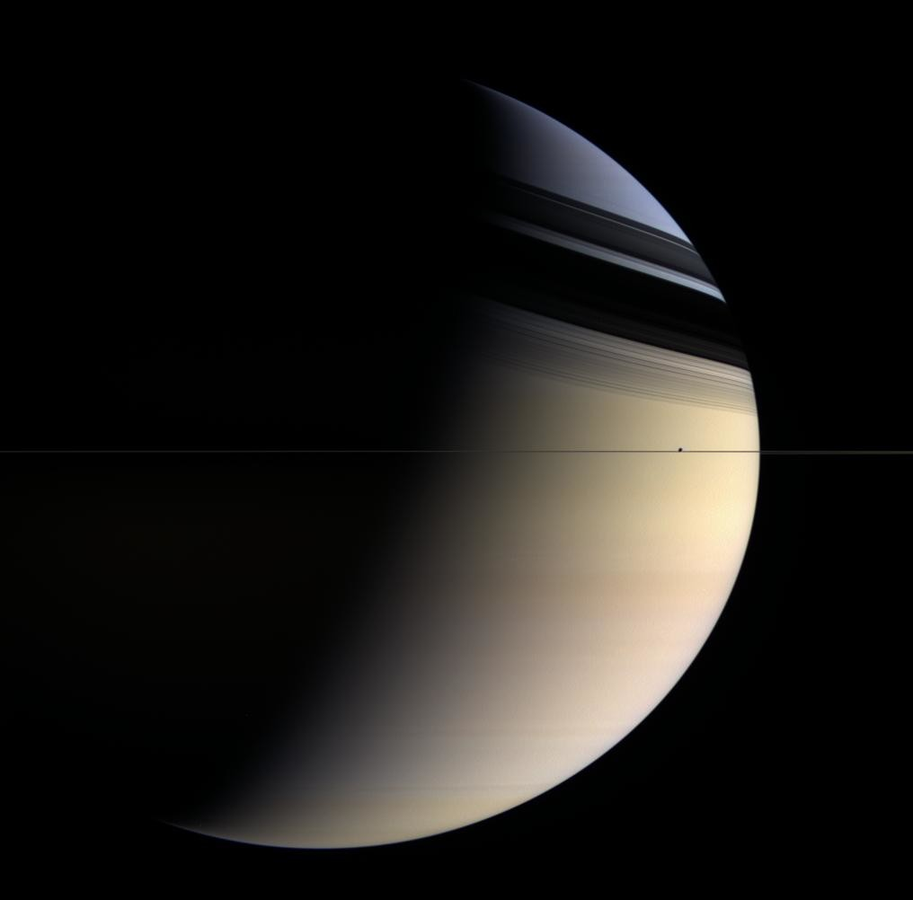 Saturn's rings are so thin that seen edge-on they virtually disappear... but they cast quite a shadow. Credit: NASA/JPL/Space Science Institute