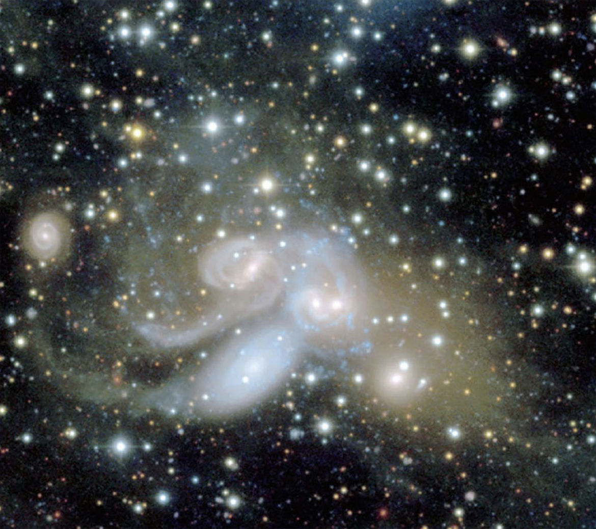 A close-up on the group of galaxies called Stephan's Quintet, with the contrast stretched to show faint diffuse material. Credit: CFHT, Pierre-Alain Duc (Observatoire de Strasbourg) & Jean-Charles Cuillandre (CEA Saclay/Obs. de Paris).