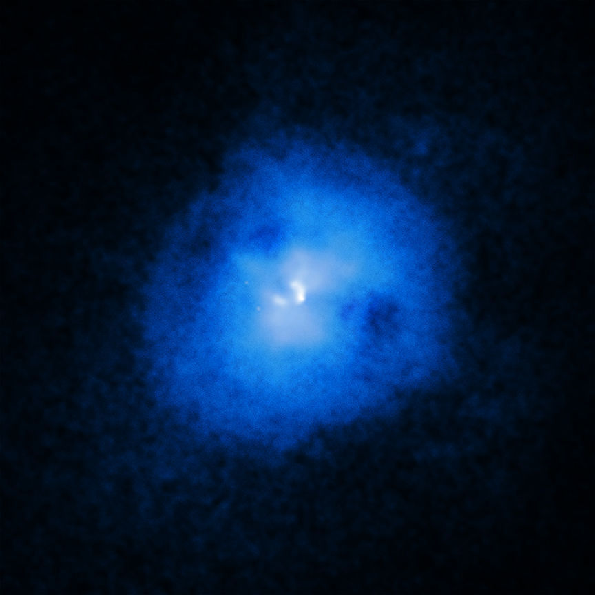 Hot gas in the cluster Abell 2597 glows in X-rays, while bubbles of gas rising inside appears as dark cavities, like eye sockets in a ghostly face. Credit: X-ray: NASA/CXC/Michigan State Univ/G.Voit et al.