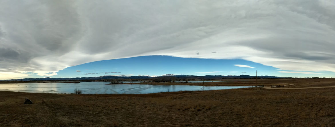 A Chinook Arch, a meteorological phenomenon where rising air over mountains forms a linear cloud edge, can be commonly seen in Colorado. Credit: Phil Plait