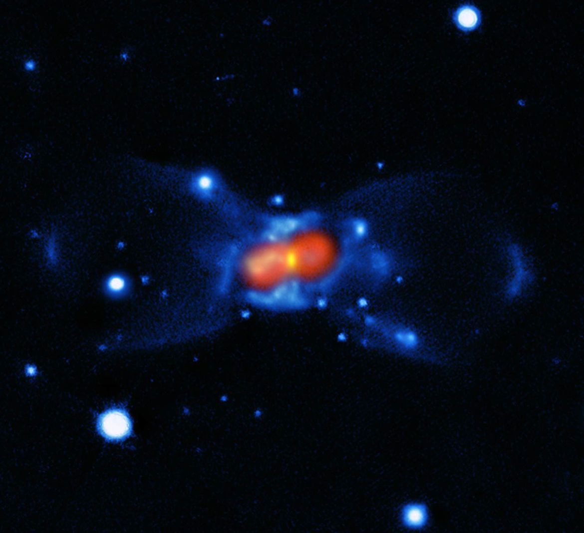 Combined visible light image from the Gemini observatory (blue) and SMA submillimeter light (red) show the complex hourglass shape of the gas and dust expanding from away from Nova Vulpeculae 1670. Credit: ESO/T. Kamiński