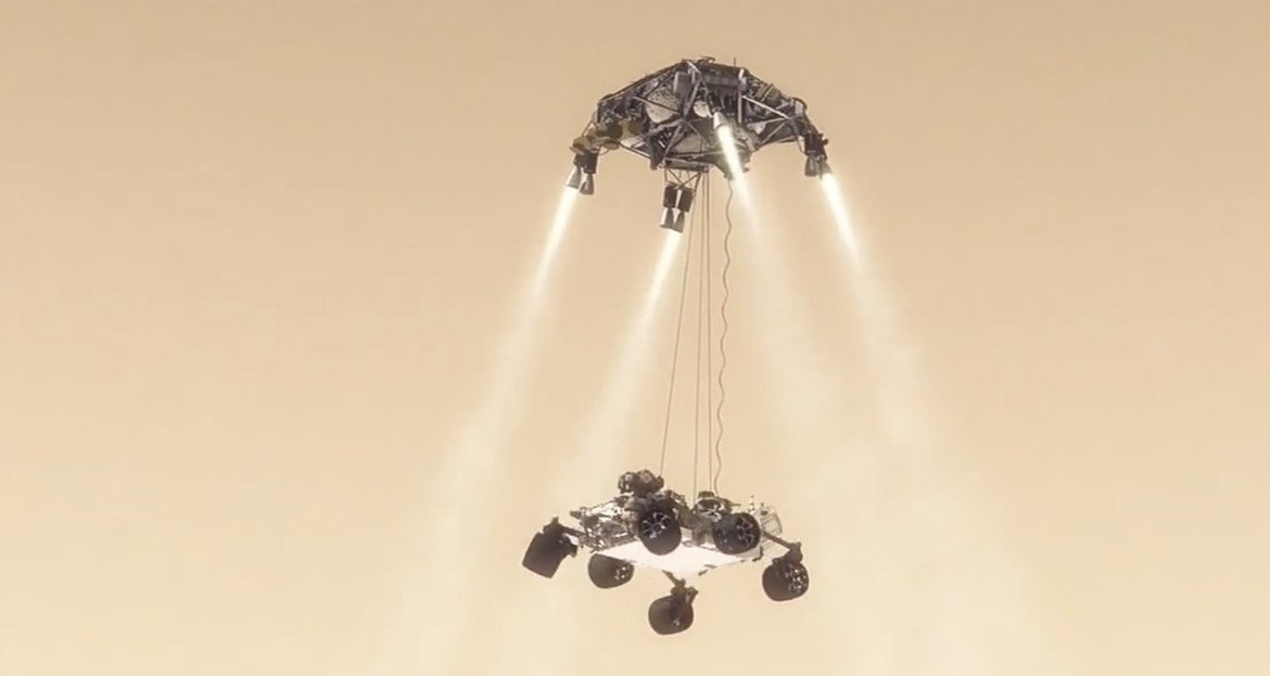 """Curiosity suspended beneath the skycrane as it descends toward Mars. Frame from the animation """"Seven Minutes of Terror"""". Credit: NASA / JPL"""