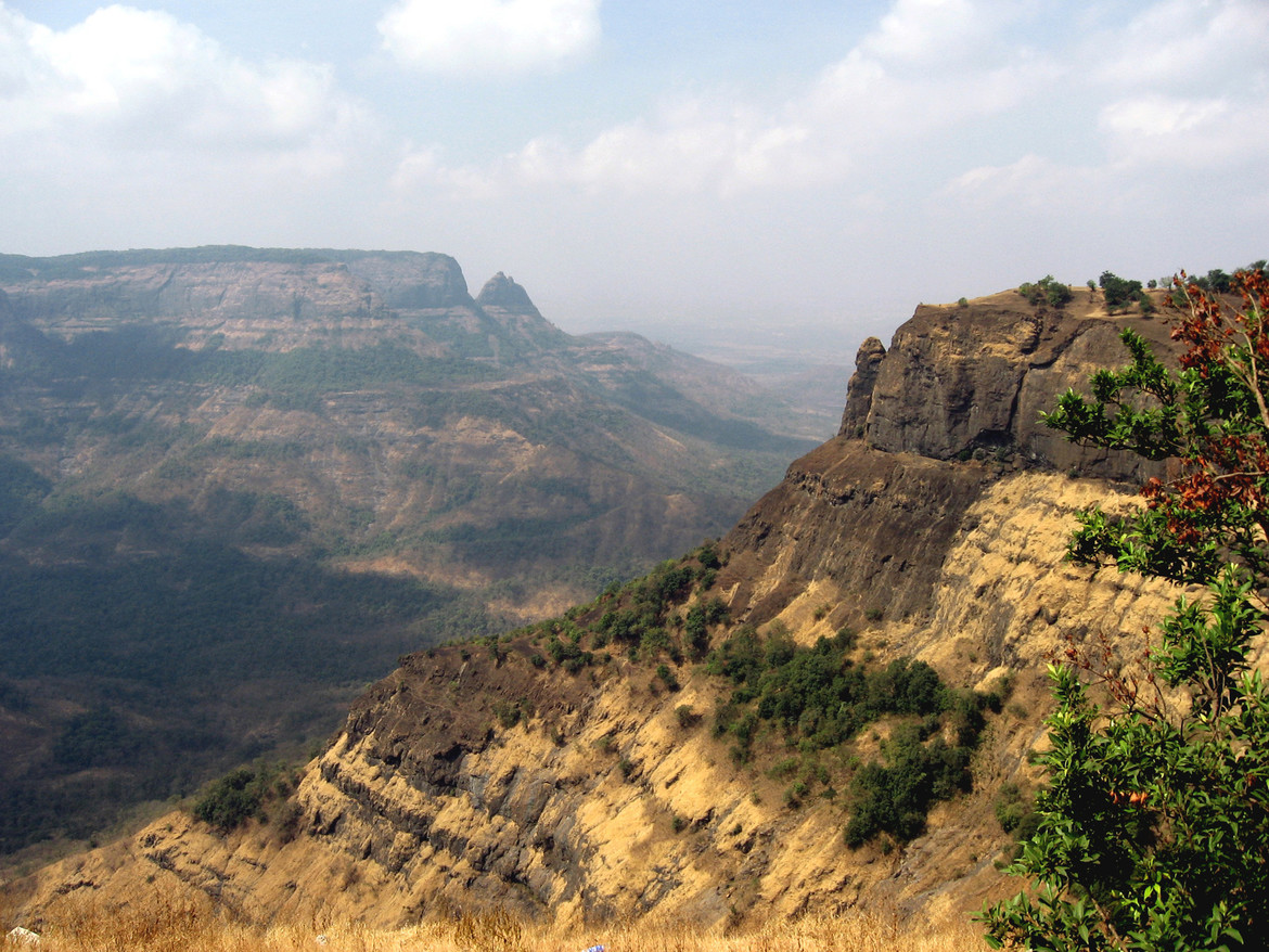 Part of the Deccan Traps in western India. See the layering? That's not sedimentary, that's igneous rock deposition, and it goes on for more than 1,000 kilometers. This was no ordinary volcanic event. Wikipedia / Nichalp