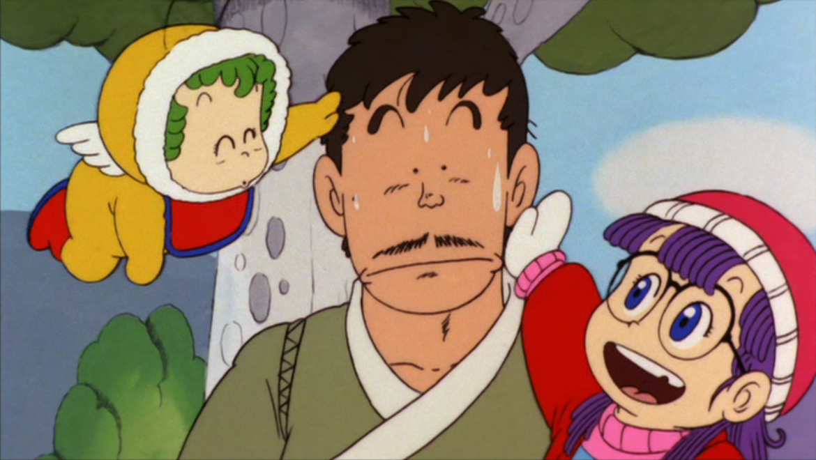 Arale pats her creator Senbei, who is suffering from self esteem problems and an overactive sweat gland.