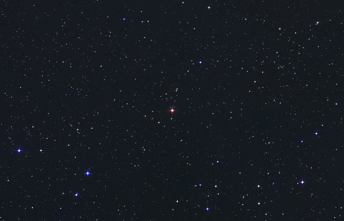 AU Mic (center), a dim red dwarf star just 32 light years from Earth. Credit: DSS/Skyview