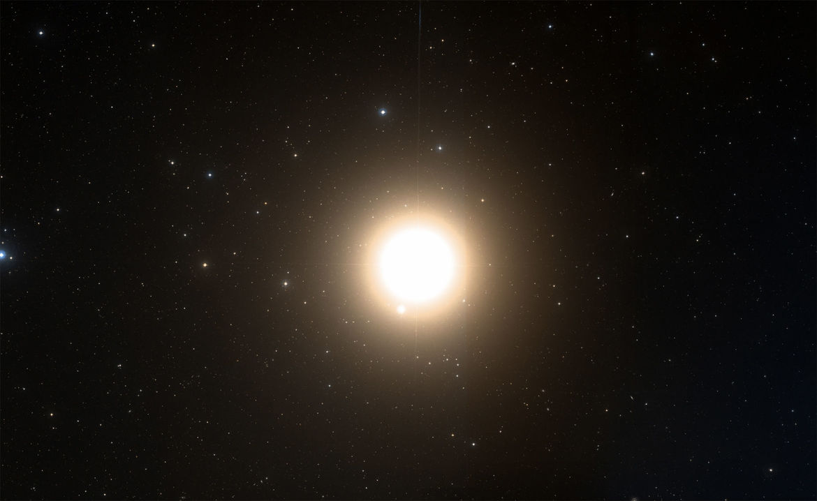 Arcturus is a red giant star that happens to lie just 37 light years away. It's a big star, but only looks big in this image due to being hugely overexposed. Credit: Aladin/Digitized Sky Survey