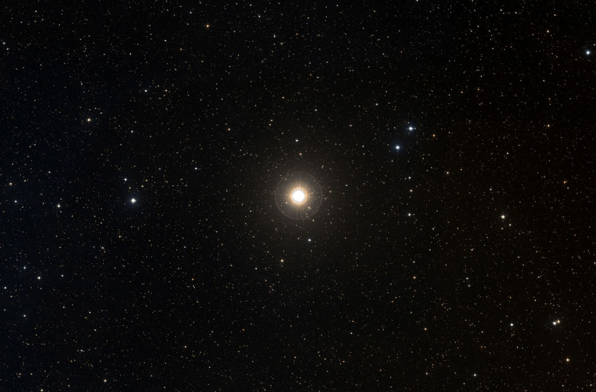 The bright star Gamma Cephei (actually a very close binary star), host to the very first confirmed exoplanet discovered. Credit: ALADIN / Digitized Sky Survey