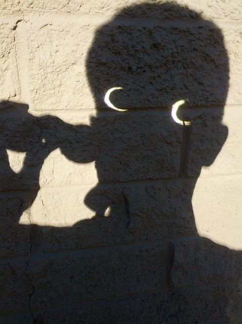 projecting eclipse with binoculars