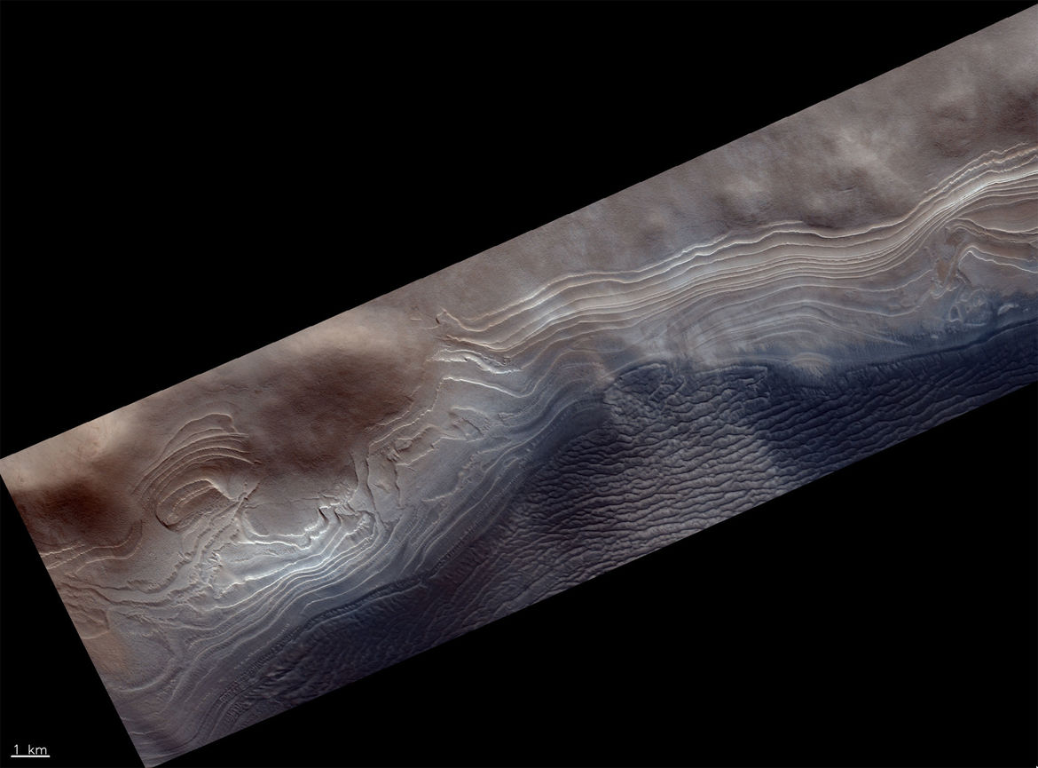 Layered deposits of ice and dust near the south pole of Mars. Credit: ESA/Roscosmos/CaSSIS, CC BY-SA 3.0 IGO