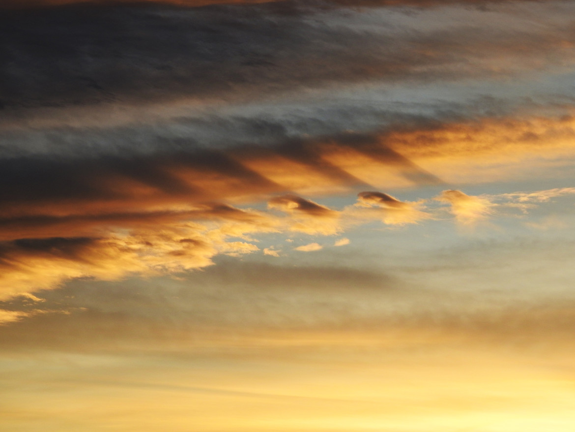 Fluctus at sunset: Wave clouds created by a layer of air flowing over another. The shadows are striking. Credit: Phil Plait