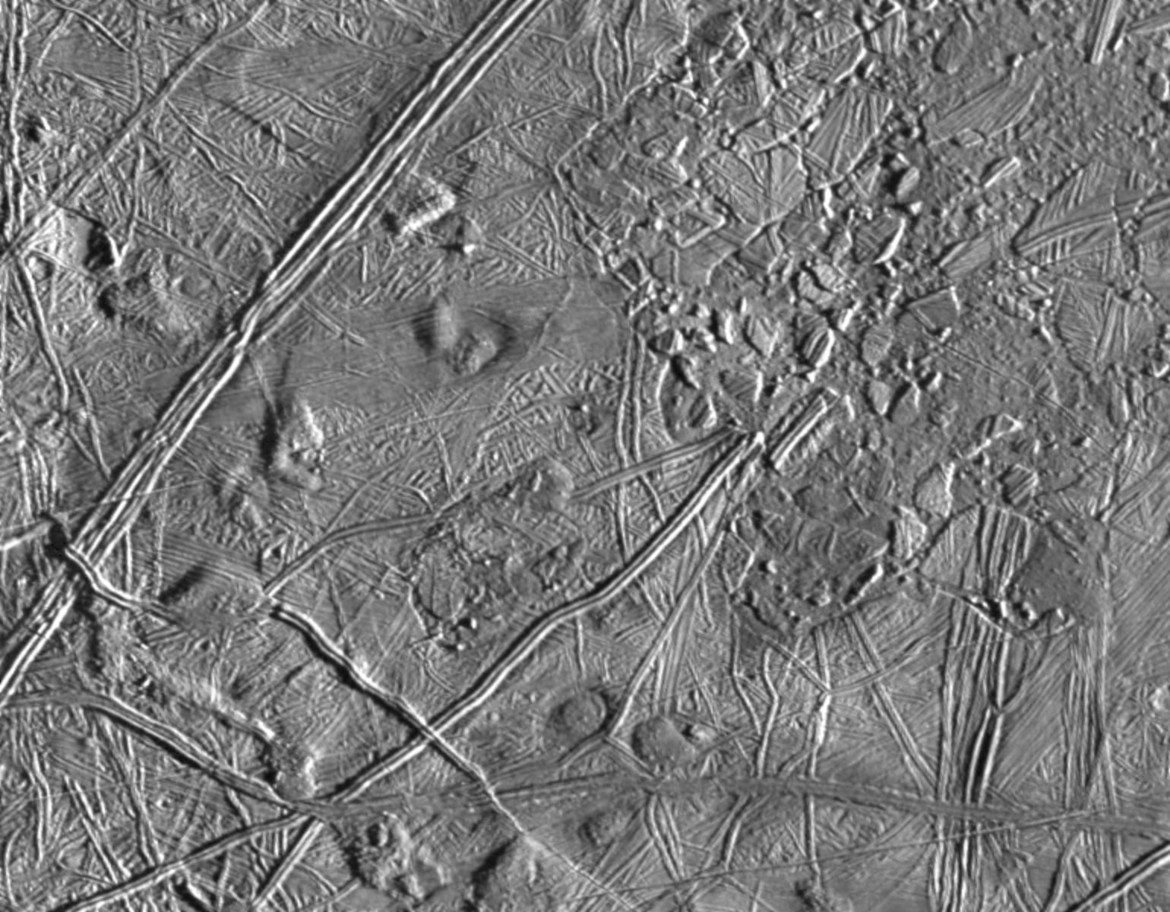 "The Galileo spacecraft saw cracks and fissures in this ""chaotic"" region of Europa, evidence of a liquid ocean under the surface. Credit: NASA/JPL/ASU"