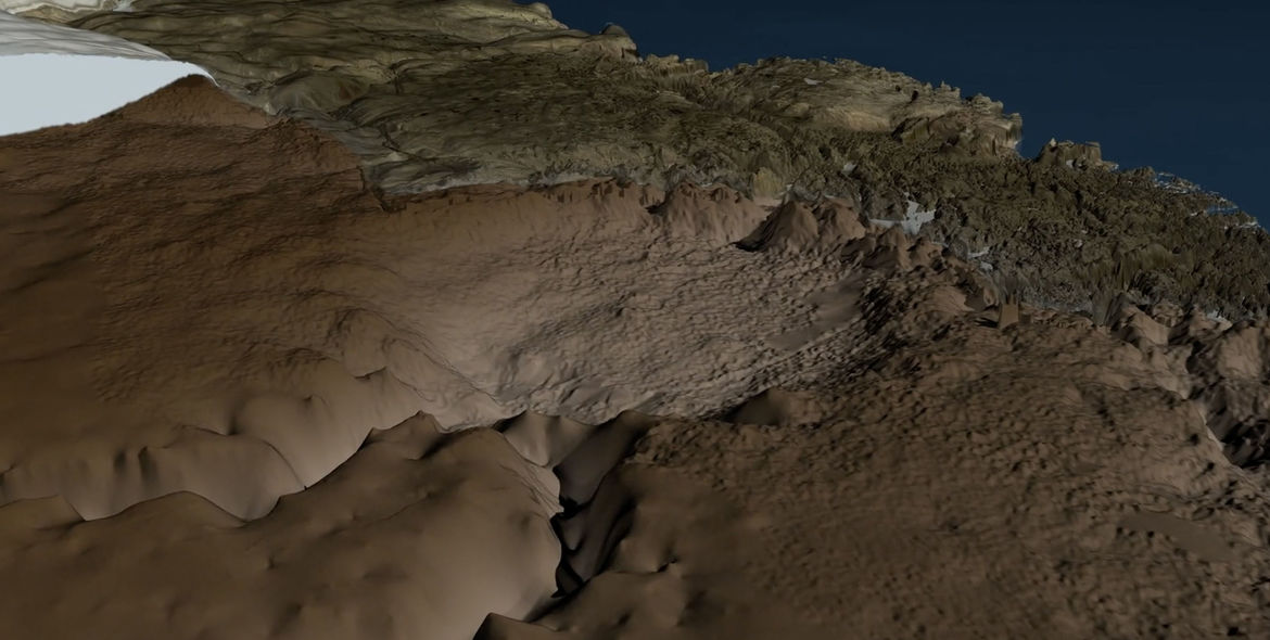 3D rendered topography of the Hiawatha glacier impact site in NW Greenland. The circular crater bowl is clearly seen, as are sharp rim peaks and the central peak cluster. Credit: Natural History Museum of Denmark, Cryospheric Sciences Lab, NASA/GFSC