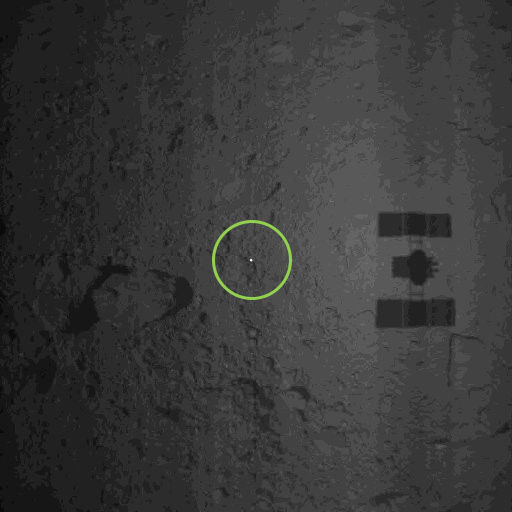 """Hayabusa-2 dropped a """"target marker"""" (bright spot inside green circle) on the surface of Ryugu to help measure the spacecraft's motion as it approaches the asteroid's surface. Credit: JAXA"""