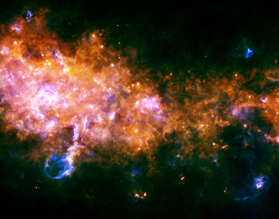 Far-infrared Herschel observatory image of cold dust and gas in the Milky Way. Note the blowout at the lower left. Credit: ESA/Hi-GAL Consortium