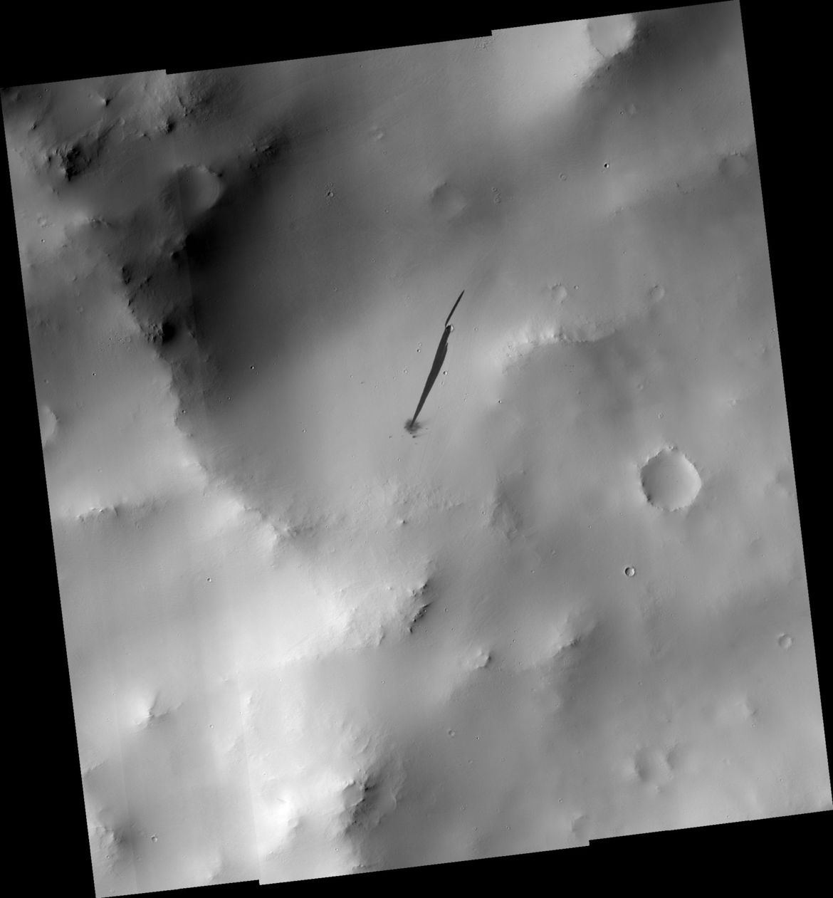 A wider view of the impact site shows the varying terrain, covered in light-colored dust. Credit: NASA/JPL/University of Arizona
