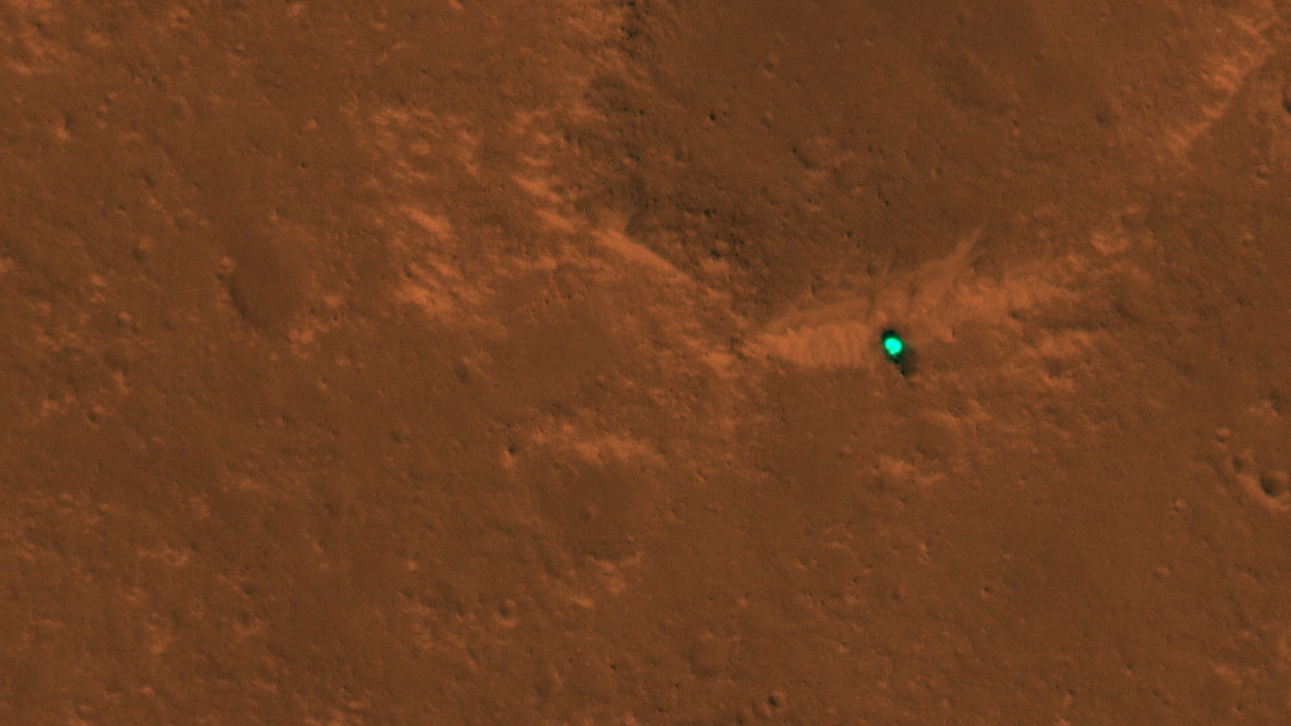 The Mars InSight heat shield on the surface of the planet, dropped before touchdown. Credit:  NASA/JPL/University of Arizona