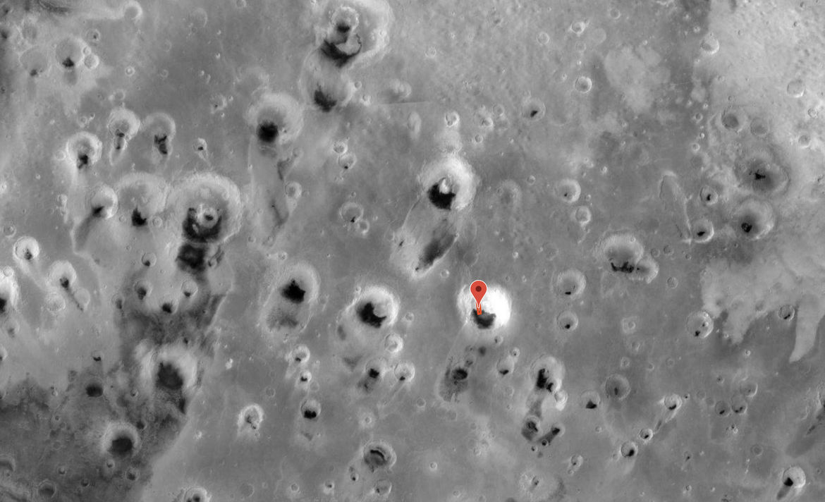 hirise_A field of enormous craters on Mars, many of which have sand blown in them. The red rectangle marks the location and orientation of the Pac-Man dune image Credit: NASA/JPL/ASU/MSSSpacmandune_context