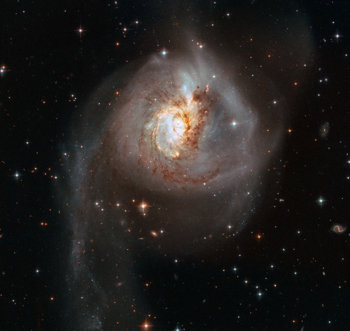 NGC 3256 is the aftermath of a cosmic collision, two huge spiral galaxies that have smashed into each other and merging. Credit: ESA/Hubble, NASA