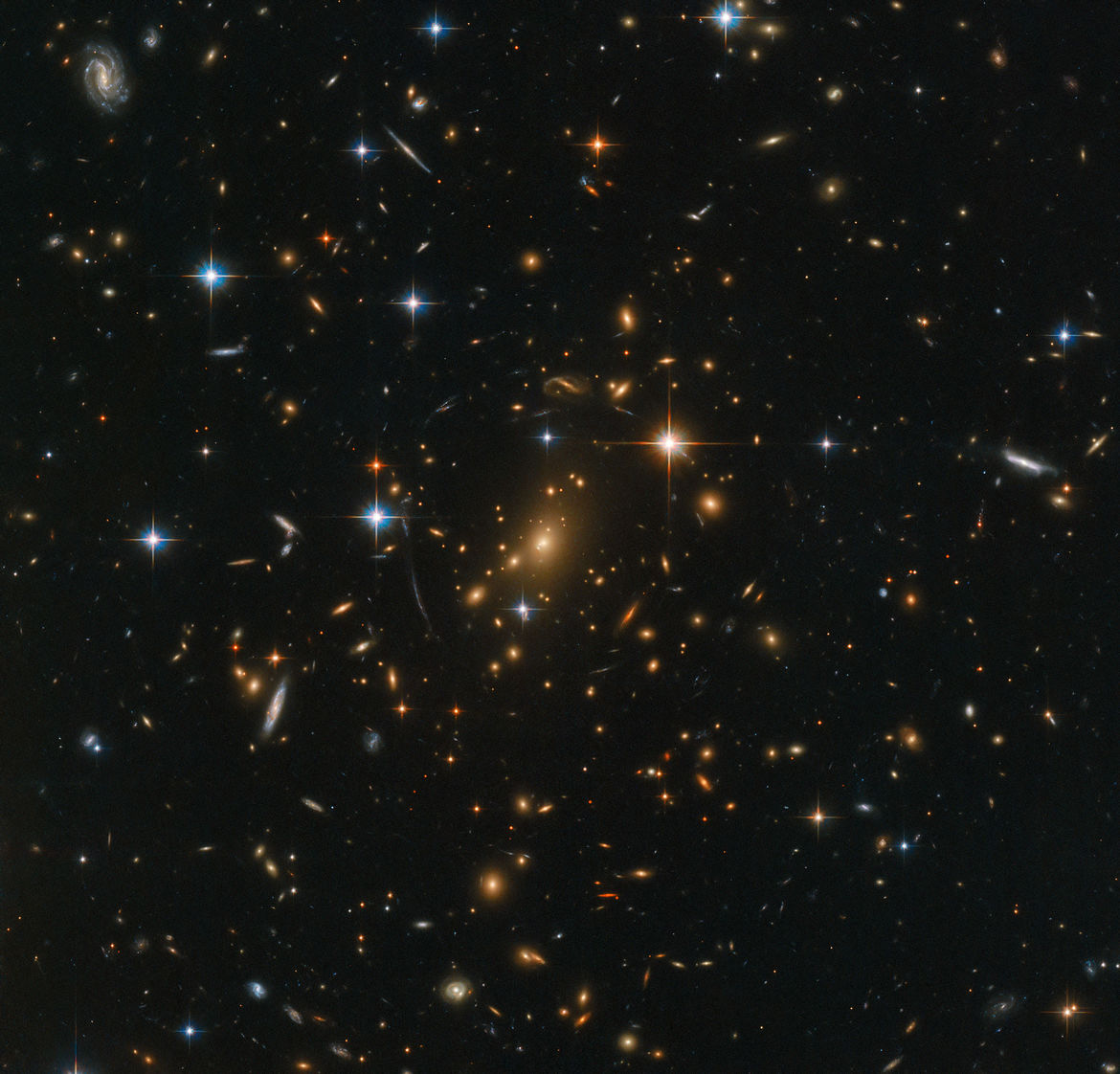 The gigantic galaxy cluster RXC J0142.9+4438 contains several hundred galaxies, and was observed by Hubble to study even more distant background galaxies whose light was amplified by the gravity of the cluster. Credit: ESA/Hubble & NASA, RELICS