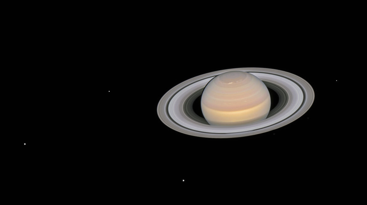Saturn and its moons, observed by Hubble on June 6, 2018. Credit: NASA, ESA, A. Simon (GSFC) and the OPAL Team, and J. DePasquale (STScI)