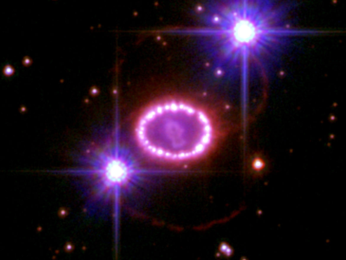 The three rings of gas surrounding Supernova 1987A, imaged by the Hubble Space Telescope to celebrate the 20th anniversary of the event. Credit: NASA, ESA, and R. Kirshner (Harvard-Smithsonian Center for Astrophysics)