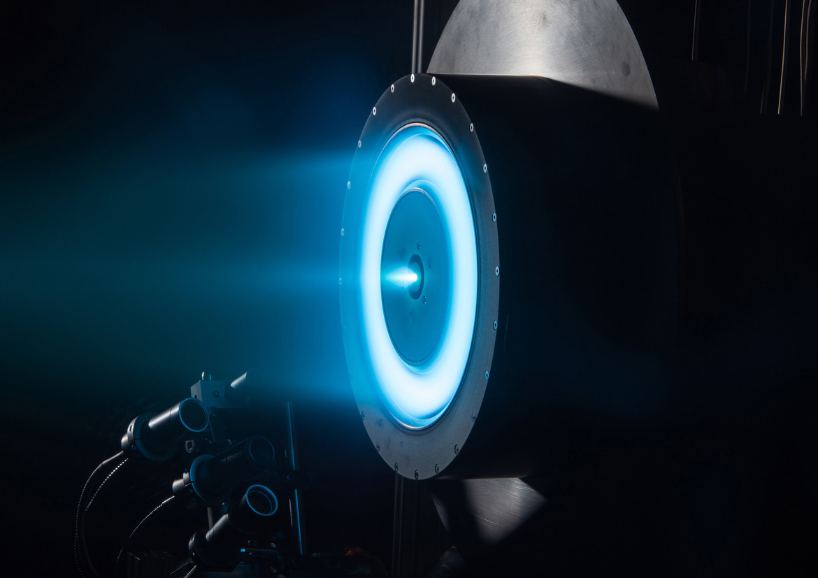 A typical ion drive uses xenon, which glows blue as the gas is blasted out the back.  Credit: NASA