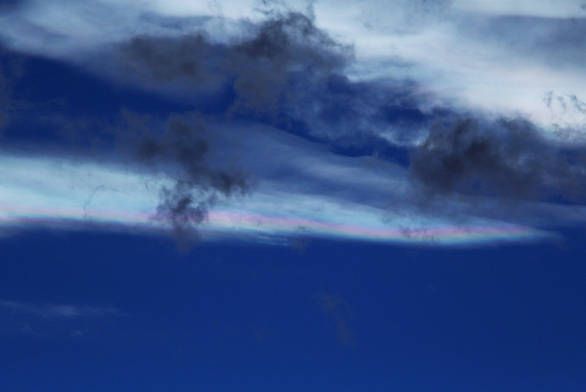 Iridescent clouds over Boulder, with the contrast enhanced to show the colors. Credit: Phil Plait