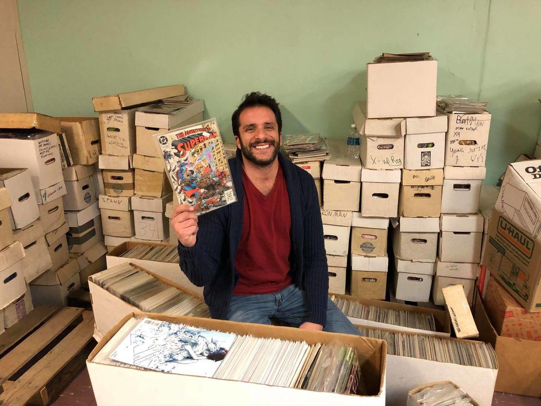 Nick Coglianese digging through comic books