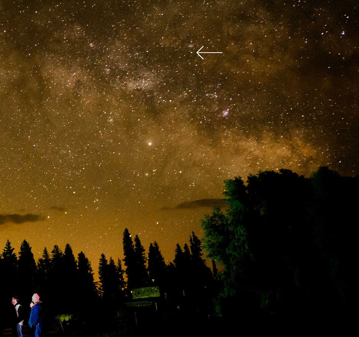 The night sky from rural Colorado, showing the Milky Way, some folks gathered 'round a telescope (that's me on the right), and the protoplanet Vesta (arrowed). Credit: Michele Wedel