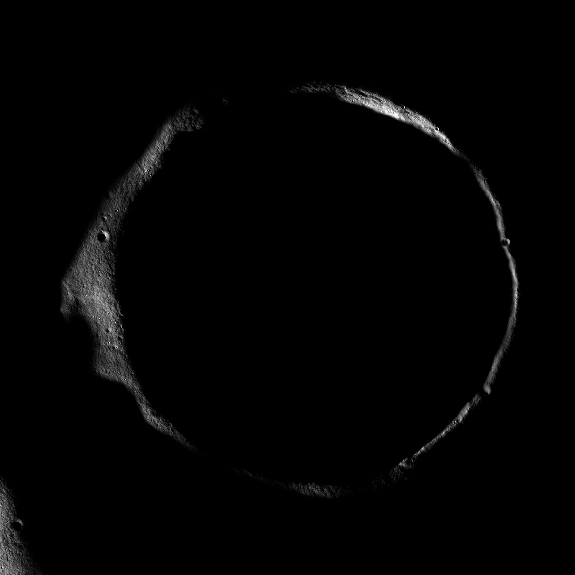 Erlanger crater, near the Moon's north pole, with just its rim lit by low sunlight. Credit: NASA/GSFC/Arizona State University