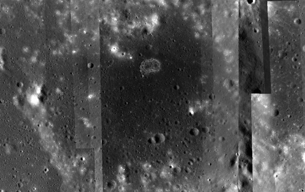 The lunar irregular mare patch Ina, a weird formation that is likely volcanic in origin, but more than that no one can say. The strips are a processing artifact; this is a mosaic of many images. Credit: NASA/GSFC/Arizona State University / Quickmap