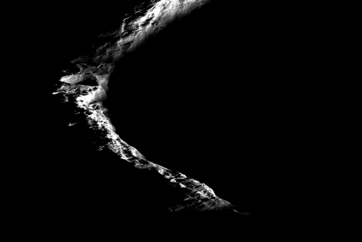 Detail on Shackleton crater's rim, showing craters and boulders. Credit: NASA/GSFC/Arizona State University