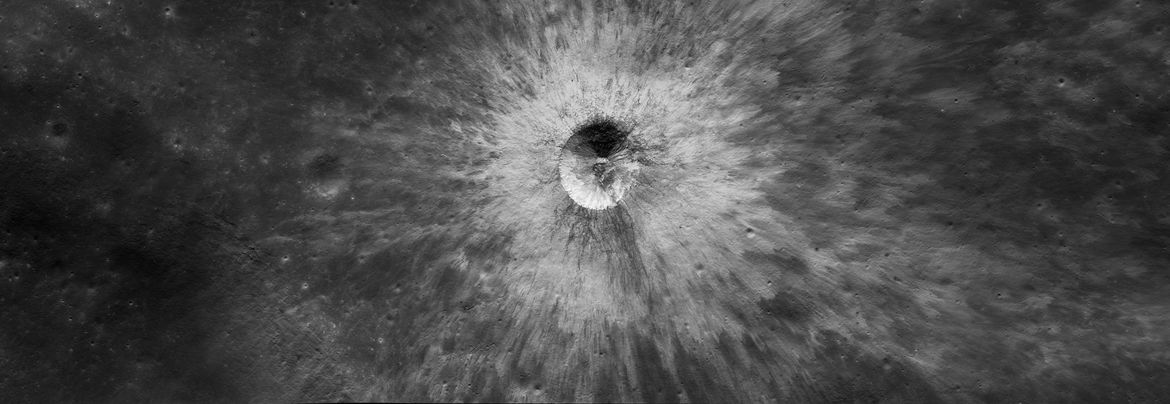 An unnamed crater, young and fresh, near the western edge of the Moon's near side.  Credit: NASA/GSFC/Arizona State University