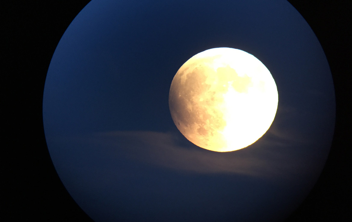 Near the beginning of the September 27, 2015 lunar eclipse, the Moon was rising in the east and accented by thin clouds. Credit: Phil Plait