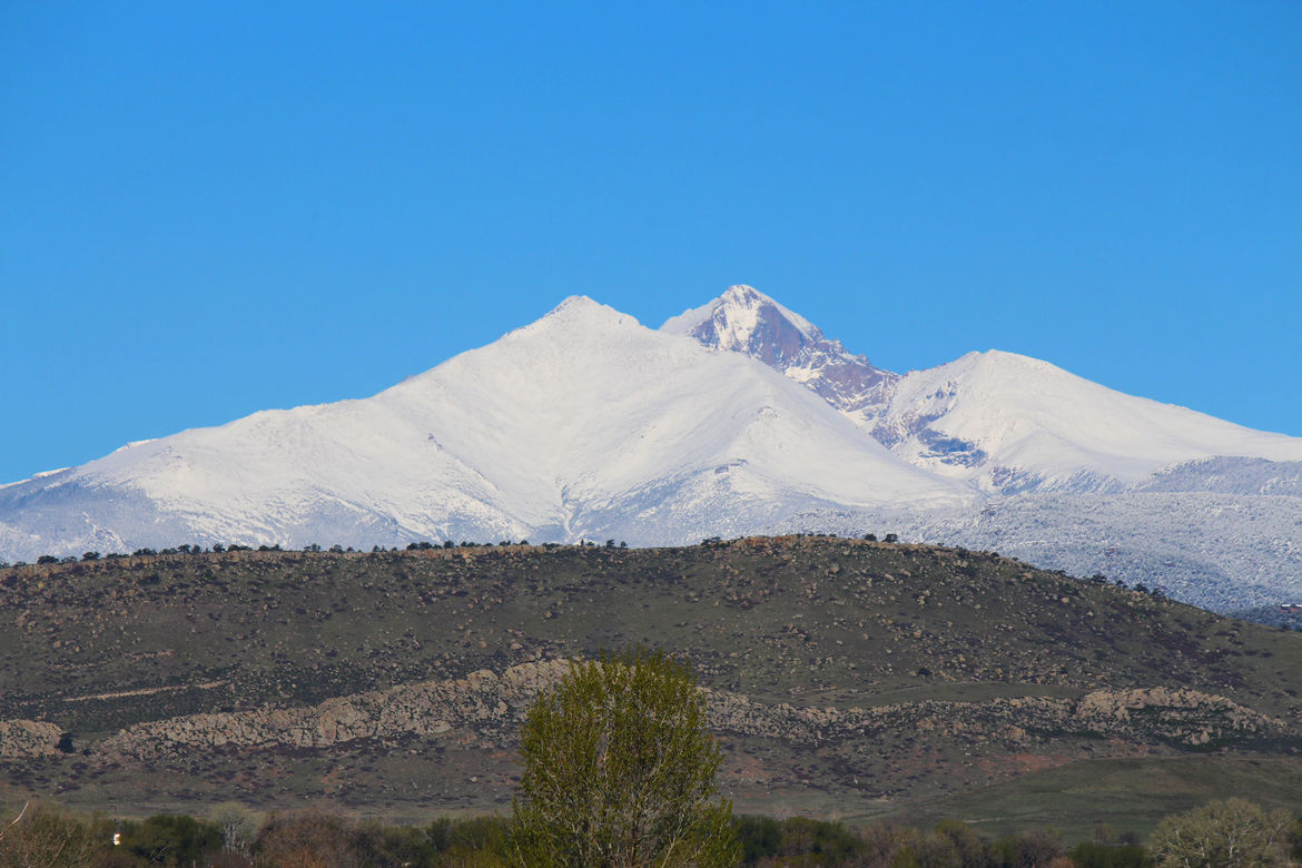 Mount Meeker (front) and Longs Peak, the two tallest mountains in Rocky Mountain National Park, under a blue Colorado sky. Credit: Phil Plait