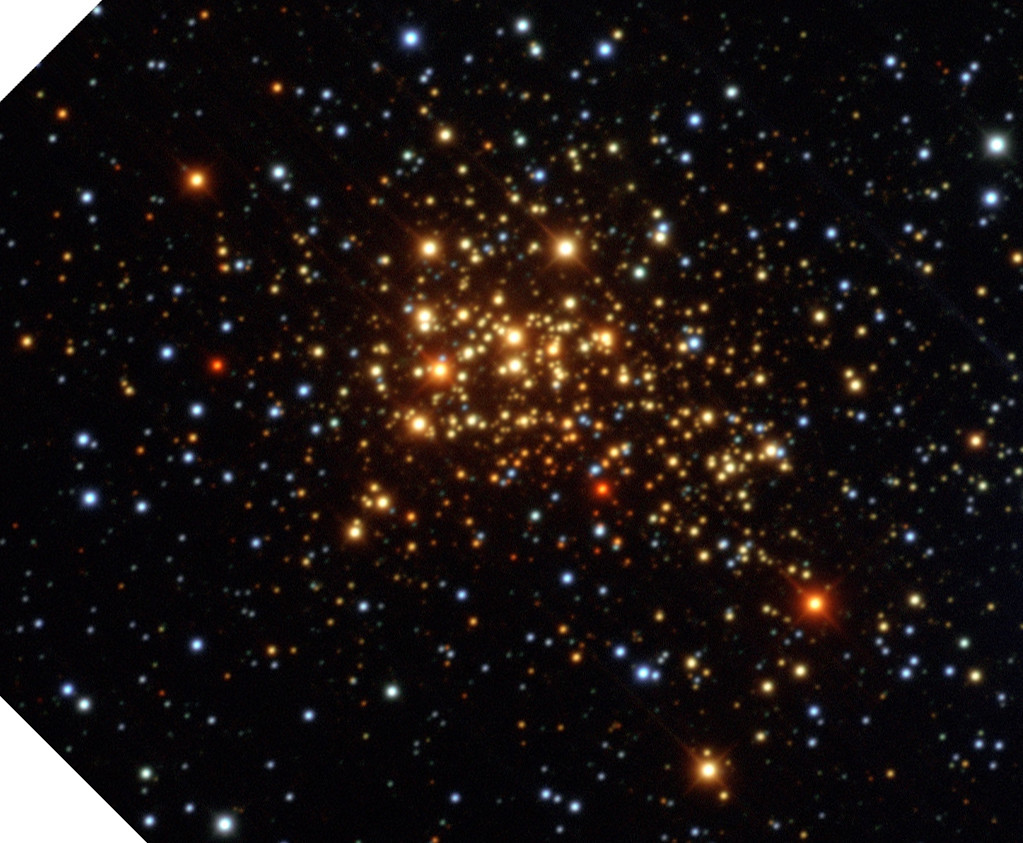 In visible light, the massive star cluster Westerlund 1 appears to be very red, but that's due to dust between us and it. Credit: ESO