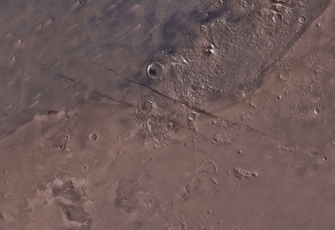 An overview of the Elysium Planitia area containing the Cerberus Fossae cracks. The two long cracks are each about 500 km long. Credit: NASA/JPL-Caltech/University of Arizona