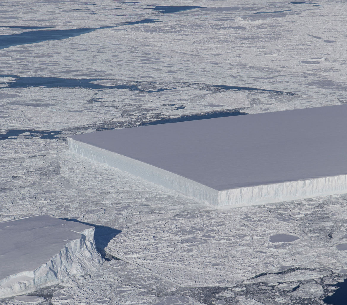 The straight edge and right angles of a large iceberg seen by a NASA IceBridge airplane in October 2018. Credit: NASA / Jeremy Harbeck